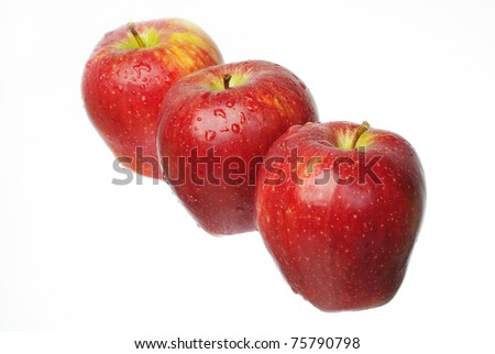 Three ripe red apples