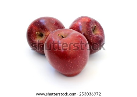 Three ripe red shiny apple on a white background - stock photo