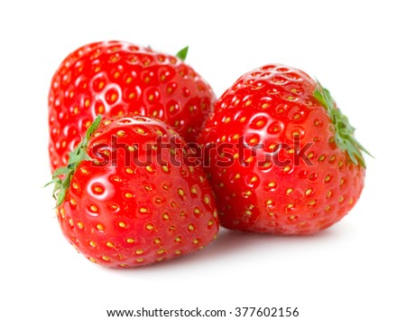 three ripe strawberries isolated on white background - stock photo