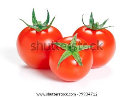 Three ripe tomato isolated on white background. - stock photo