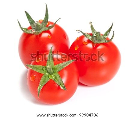 Three ripe tomato with drops isolated on white background. - stock photo