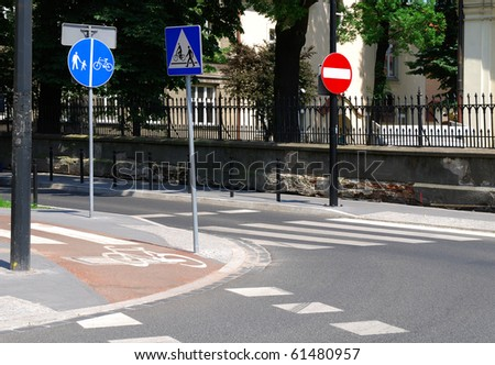 three road signs on the street in the city center - stock photo