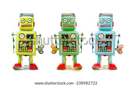 three robot toys in a line - stock photo