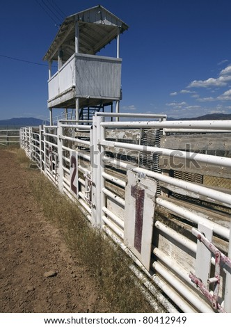 Three rodeo gates beneath the announcer's booth at a rural rodeo. - stock photo