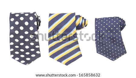 Three rolled multi-colored tie.  Isolated on white background - stock photo