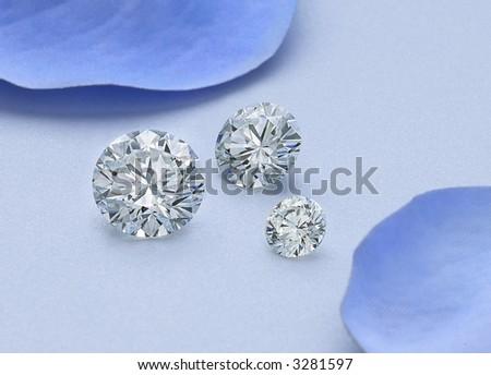 Three Round Diamonds on Blue - stock photo