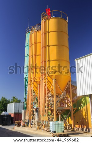 Three round metal towers on chemical plant - stock photo
