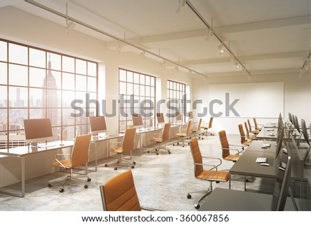Three rows of computer tables in a light modern open space office, one of them along the window. Big blank screen on the wall. New York view, filter. Concept of work. - stock photo