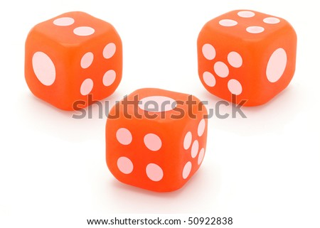 Three rubber dice arranged on white background