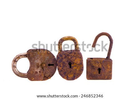 three rusty ancient metal lock isolated on white background