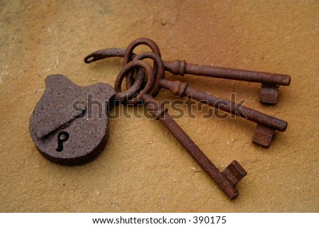 three rusty keys and lock