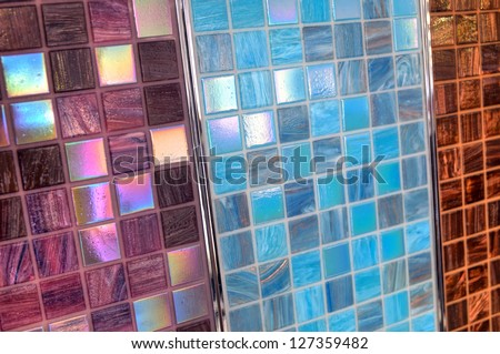 Three samples of mix shiny glass mosaic in blue and beige colors - stock photo