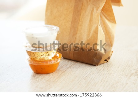 Three sauces in  small plastic bowls - stock photo