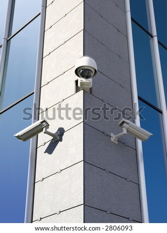 Three security cameras attached on building corner - stock photo