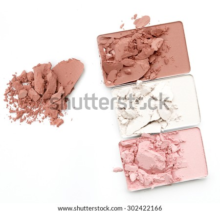 Three shade colors of make-up powder on white background - stock photo