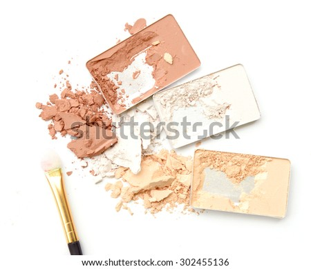 Three shade colors of make-up powder on white background - stock photo
