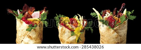 three shawarma on black background - stock photo