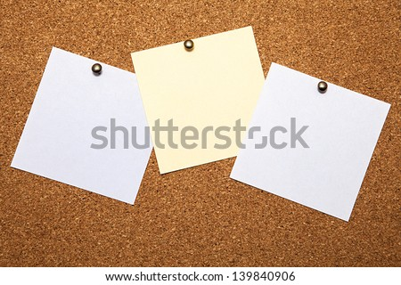 Three sheets for notes on a cork board - stock photo