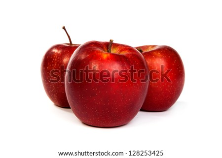 Three shiny red apples isolated on a white background
