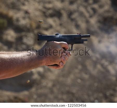 Three shots that have been just delivered from a polymer handgun - stock photo