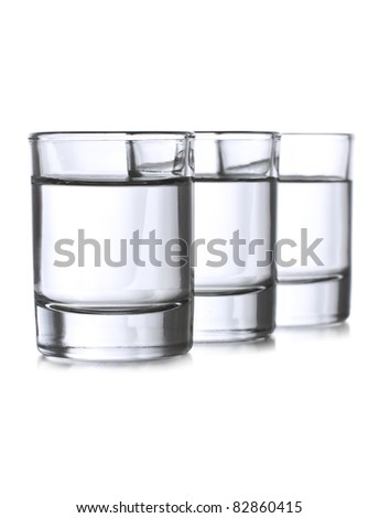 Three shots with clear liqueur - stock photo