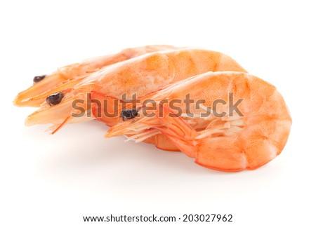 Three shrimps isolated on a white background - stock photo