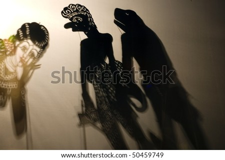 three silhouettes of light and shaow traditional asian theatre - stock photo