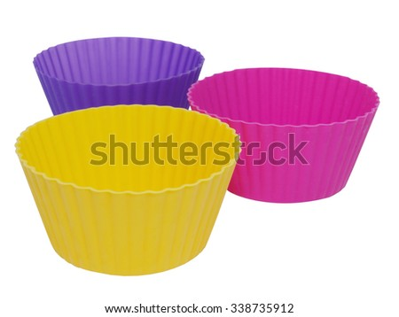 Three silicone molds for cake isolated on white background - stock photo