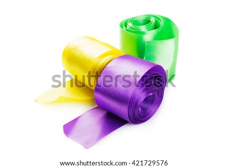 Three Silk ribbons for decoration. Rribbons twisted into a coil isolated on white background - stock photo