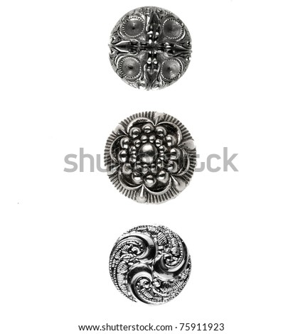 Three silver buttons placed on white background - stock photo