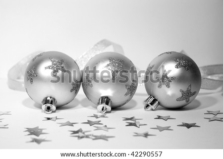 Three silver christmas balls in stars with silver ribbon - stock photo