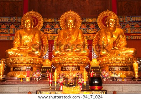 Three Sitting golden Buddha.