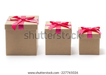 Three sizes closed carton gift boxes with red ribbons isolated on white  - stock photo