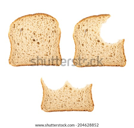Three slices of the toast bread, whole and bitten - stock photo