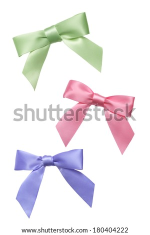 Three small pastel colored bows on white  - stock photo