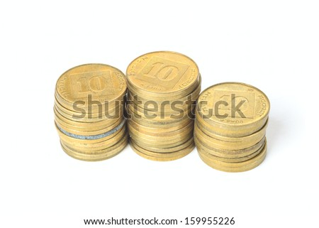Three small stacks of coins Israeli ten agorot isolated on white background - stock photo