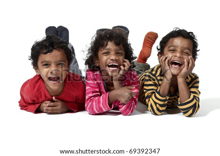 three small twins lying on a white background - stock photo