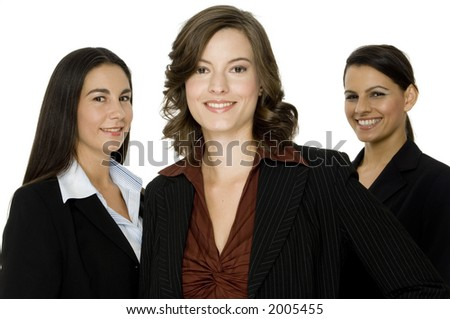 Three smart and attractive businesswomen standing as a business team