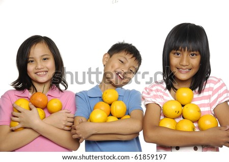 Three smile kids  holding in his hand oranges - stock photo