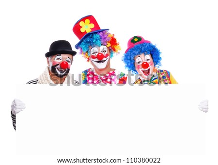 Three smiling clowns holding the blank board on white background - stock photo