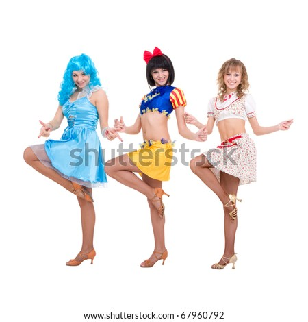 Three smiling girls dressed in doll clothes dancing on a white background
