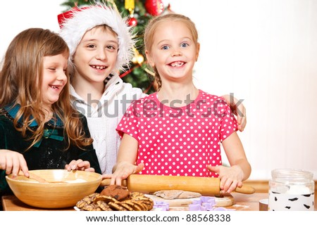 Three smiling kids cooking