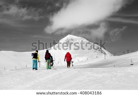 Three snowboarder on slope. Caucasus Mountains, Georgia, region Gudauri. Selective color. - stock photo