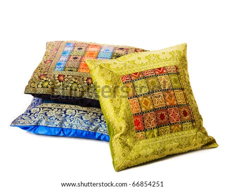 Three soft pillows lying one above another isolated on white - stock photo