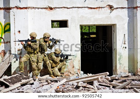 Three soldiers attacked the camp of terrorists - stock photo