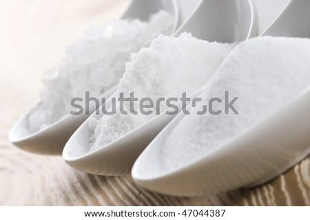 three spoons with difrent salt - stock photo