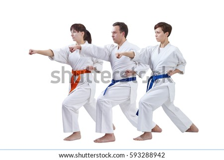 Three sportsmen are training blows hand on a white background