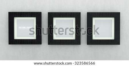 Three square size of black wooden picture frames on grey concrete wall