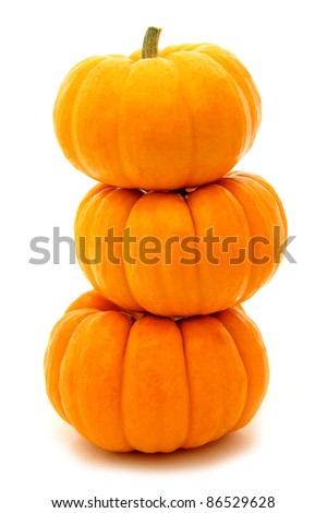 Three stacked mini pumpkins over white - stock photo