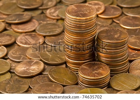 Three stacks of pennies. - stock photo